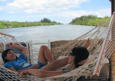 Relaxing In A Hammock On Tiki Cruise Boat